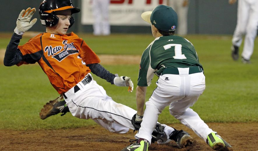 Pearland third baseman Presley Smith (7) tags out Cumberland's CJ Davock attempting to steal third to end the third inning of a baseball game in United States pool play at the Little League World Series tournament in South Williamsport, Pa., Friday, Aug. 15, 2014. (AP Photo/Gene J. Puskar)
