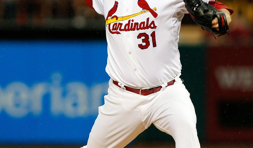 St. Louis Cardinals starting pitcher Lance Lynn throws during the first inning of a baseball game against the San Diego Padres Friday, Aug. 15, 2014, in St. Louis. (AP Photo/Scott Kane)