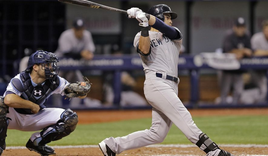 New York Yankees' Jacoby Ellsbury strikes out against Tampa Bay Rays relief pitcher Brad Boxberger with the bases loaded during the eighth inning of a baseball game Friday, Aug. 15, 2014, in St. Petersburg, Fla. Catching for the Rays is Curt Casali. (AP Photo/Chris O'Meara)