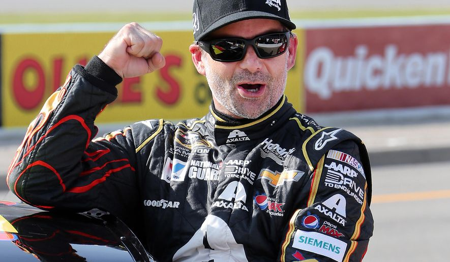 Jeff Gordon celebrates winning the pole position for the NASCAR Sprint Cup Series auto race at Michigan International Speedway in Brooklyn, Mich., Friday, Aug. 15, 2014. (AP Photo/Bob Brodbeck)