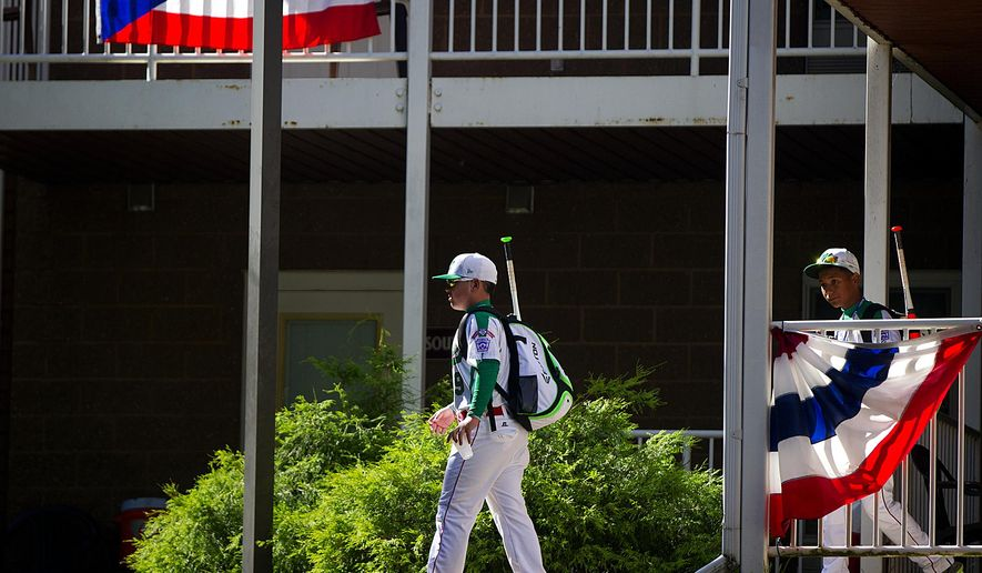 The Mexico team leaves their dorm room at the International Grove, the village where the players live during the Little League World Series tournament on Aug. 15, 2014, in Williamsport, Pa. (AP Photo/PennLive.com, Sean Simmers)