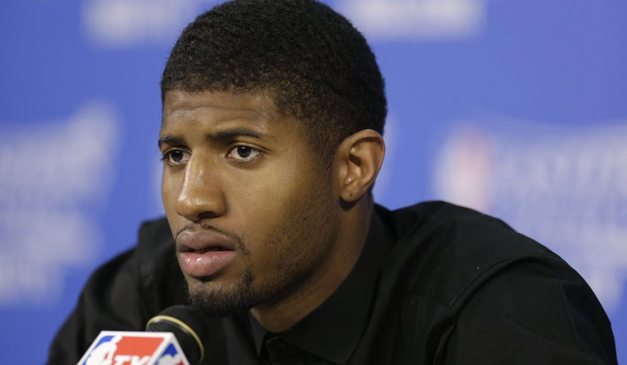 FILE - In this May 31, 2014, file photo, Indiana Pacers forward Paul George speaks during the the post-game news conference after Game 6 in the NBA basketball playoffs Eastern Conference finals in Miami. The Pacers expect George to make a full recovery from his gruesome injury _ they're just not planning on having him in the lineup next season. (AP Photo/Lynne Sladky, File)