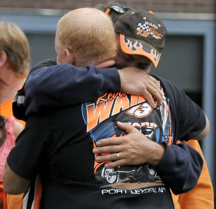 People embrace outside the funeral service for Kevin Ward Jr. at South Lewis Central School in Turin, N.Y., Thursday, Aug. 14, 2014. Ward, a dirt-track racer, was killed by NASCAR champion Tony Stewart during a race last weekend. (AP Photo/Observer-Dispatch, Tina Russell)