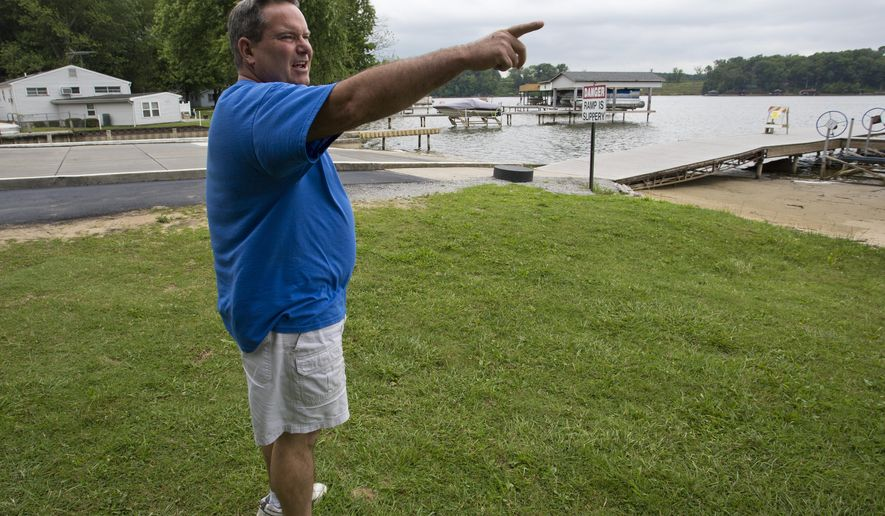 Gary Creigh, owner of Tall Timbers Marina, talks about the low water levels on Lake Freeman Tuesday, Aug. 12, 2014, near Monticello, Ind. Low water levels on the lake, which were diverted to the Tippecanoe River to help water-deprived mussels, have caused boating and business problems. Creigh laid off four workers because of a lack of business. (AP Photo/Journal & Courier, Michael Heinz)