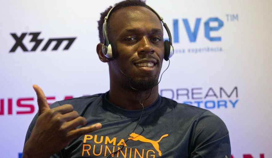 Jamaican Usain Bolt, Olympic gold medalist, strikes a pose during a press conference promoting the 'Mano a Mano' challenge, in Rio de Janeiro, Brazil, Friday, Aug. 15, 2014. Bolt will compete Sunday on a track specially built for the athletic competition at Copacabana Beach. (AP Photo/Silvia Izquierdo)