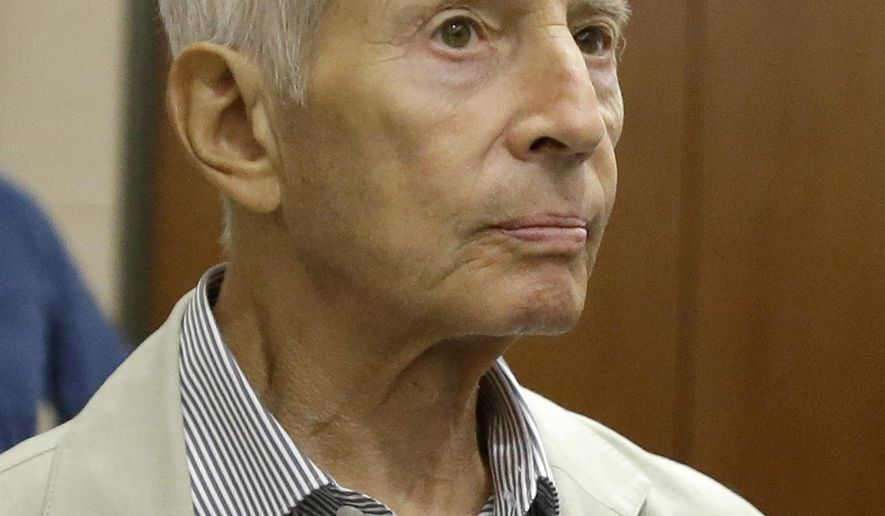 New York City real estate heir Robert Durst leaves a Houston courtroom Friday, Aug. 15, 2014. Charged with criminal mischief for urinating on candy at a Houston drug store, his hearing has been reset for next month. (AP Photo/Pat Sullivan)