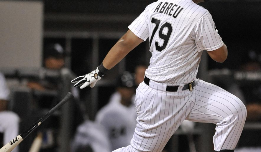 Chicago White Sox's Jose Abreu watches his 2 RBI single during the fifth inning of a baseball game against the Toronto Blue Jays in Chicago, Friday, Aug. 15, 2014. (AP Photo/Paul Beaty)