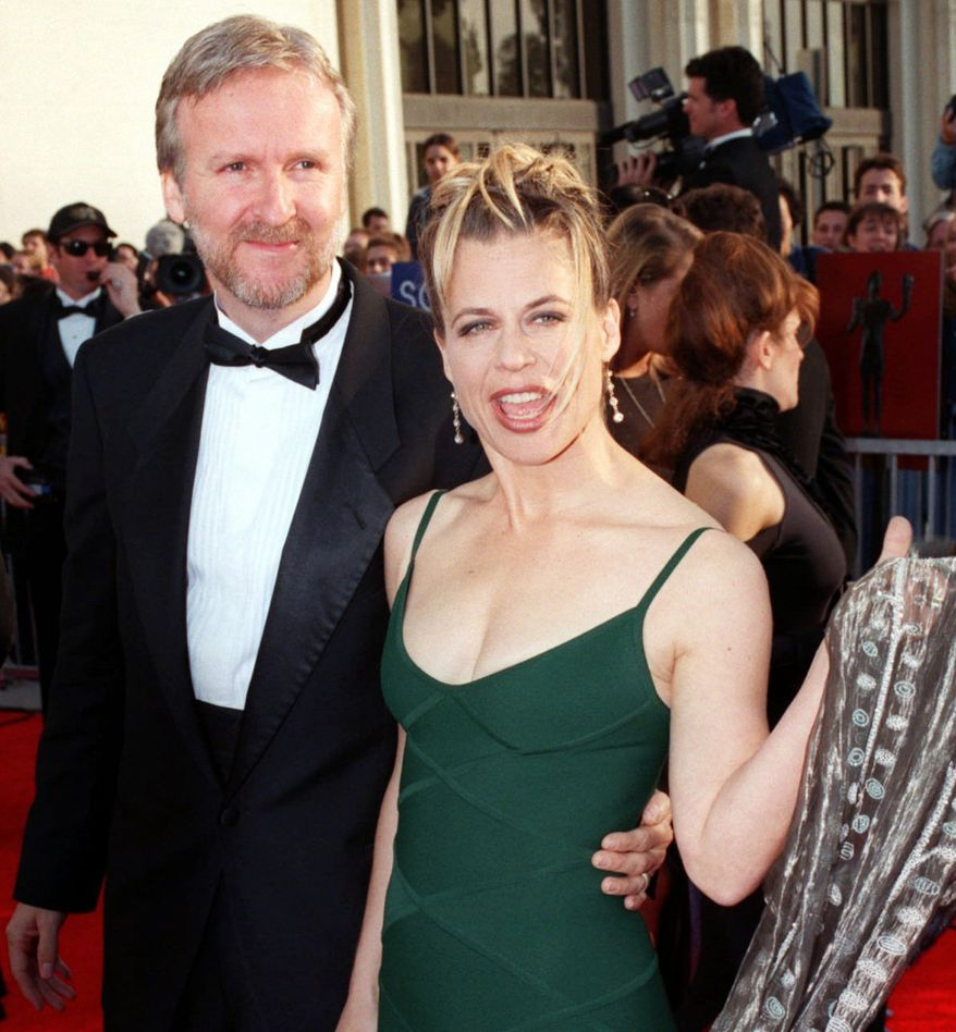 """12. Director James Cameron and actress Linda Hamilton settled their divorce in 1999. Cameron had to pay his wife $50 million, $25 million for each year they were married.  """"Titanic"""" Director James Cameron, left, arrives with actress Linda Hamilton for the Screen Actors Guild Awards, Sunday, March 8, 1998, in Los Angeles. (AP Photo/Mark J. Terrill)"""