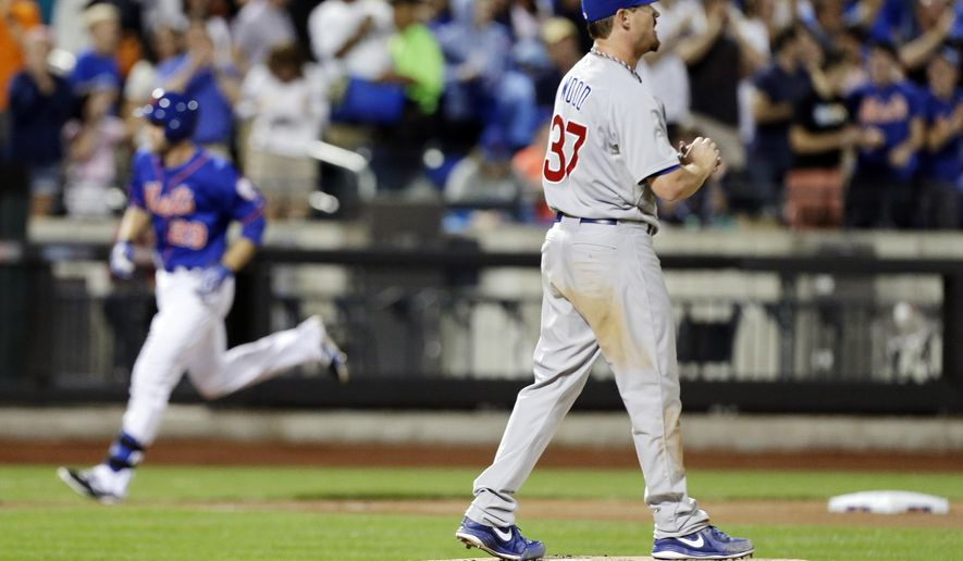 Chicago Cubs starting pitcher Travis Wood (37) reacts as New York Mets' Eric Campbell runs to home plate after hitting a three-run home run during the fourth inning of a baseball game Friday, Aug. 15, 2014, in New York. (AP Photo/Frank Franklin II)