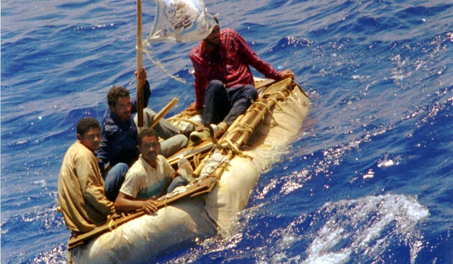 """FILE --In this Aug. 26, 1994 file photo, Cuban refugees float in heavy seas 60 miles south of Key West, Fla. In the 20 years since Fidel Castro set off a high-seas humanitarian crisis by encouraging an exodus of 35,000 islanders, more than 26,000 other Cubans have risked their lives crossing the Florida Straits. Already this year, nearly 3,000 have been picked up by U.S. authorities, on a pace to double last year's total. Experts say it shows the limits of the """"wet-foot, dry-foot"""" policy that solved the 1994 crisis. (AP Photo/Dave Martin, File)"""
