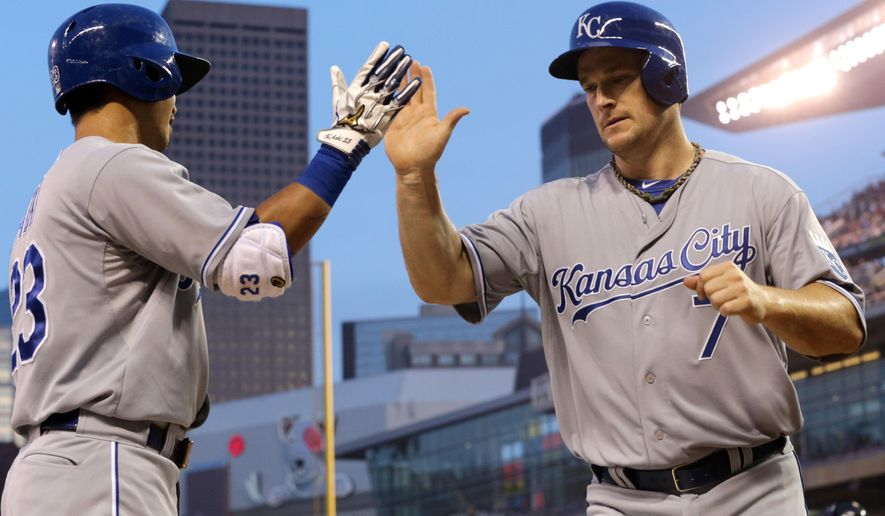 Kansas City Royals' Josh Willingham, right, is congratulated by Nori Aoki, of Japan, after scoring on a two-run triple by Alcides Escobar off Minnesota Twins pitcher Ricky Nolasco in the fourth inning of a baseball game, Friday, Aug. 15, 2014 , in Minneapolis. Willingham drove in three runs with a bases-loaded double in the inning. (AP Photo/Jim Mone)