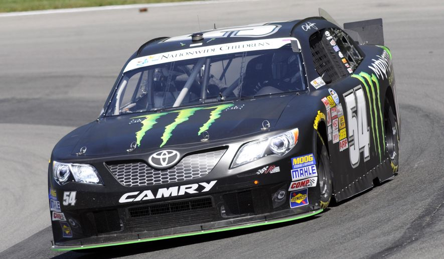 Sam Hornish Jr.  drives through a corner during practice for the NASCAR Nationwide Series Nationwide Children's Hospital 200 auto race at Mid-Ohio Sports Car Course Friday, Aug. 15, 2014 in Lexington, Ohio. (AP Photo/Tom E. Puskar)