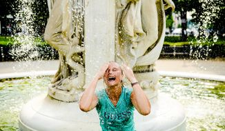 Este Strydom of Bloemfontein, South Africa cools off in the fountain at Dupont Circle, Washington, D.C., Tuesday, June 17, 2014. (Andrew Harnik/The Washington Times) **FILE**