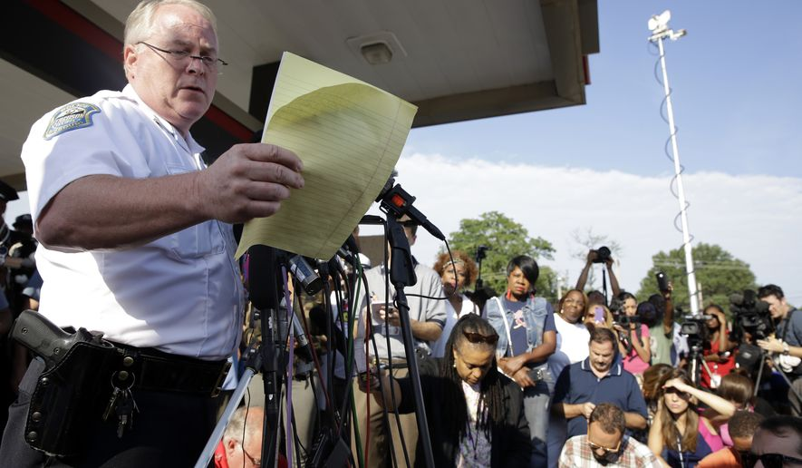 Ferguson Police Chief Thomas Jackson releases the name of the the officer accused of fatally shooting an unarmed black teenager Friday, Aug. 15, 2014, in Ferguson, Mo. Jackson announced that the officer's name is Darren Wilson. (AP Photo/Jeff Roberson)