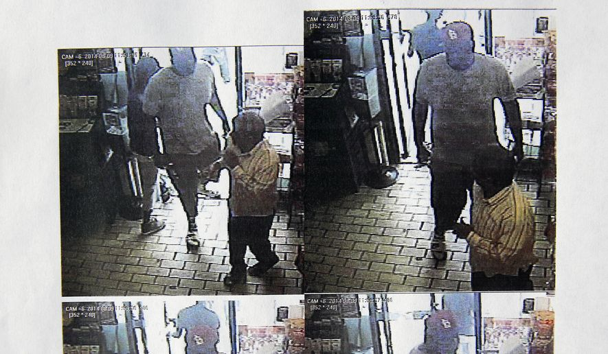 "Raynard Jackson deplores rap glorifying ""thug life and prison culture."" Above: Michael Brown in video images from convenience store police say the teen robbed on night he was fatally shot. (AP Photo/Ferguson Police Department)"