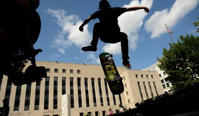 Colin McPheeters, 20, of Fredrick, Md., skates in front of the E. Barrett Prettyman United States Courthouse, Washington, D.C., Wednesday, August 13, 2014. (Andrew Harnik/The Washington Times)