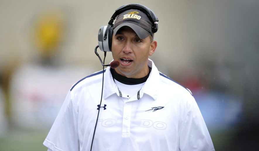 FILE - In this Oct. 19, 2013, file photo, Toledo head coach Matt Campbell talks during an NCAA college football game against Navy in Toledo, Ohio. Now that Chris Petersen has left Boise State for Washington, college football needs another coach from outside the so-called Big 5 conferences that will have his name come up for almost every big job. (AP Photo/David Richard, File)