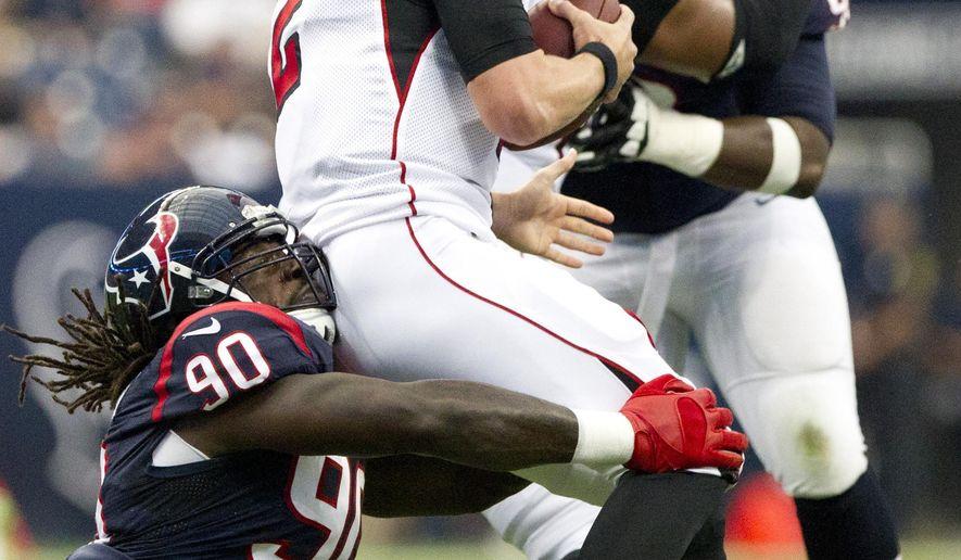 Houston Texans linebacker Jadeveon Clowney (90) sacks Atlanta Falcons quarterback Matt Ryan (2) in the first quarter of an NFL preseason football game, Saturday, Aug. 16, 2014, in Houston. (AP Photo/Conroe Courier, Jason Fochtman)