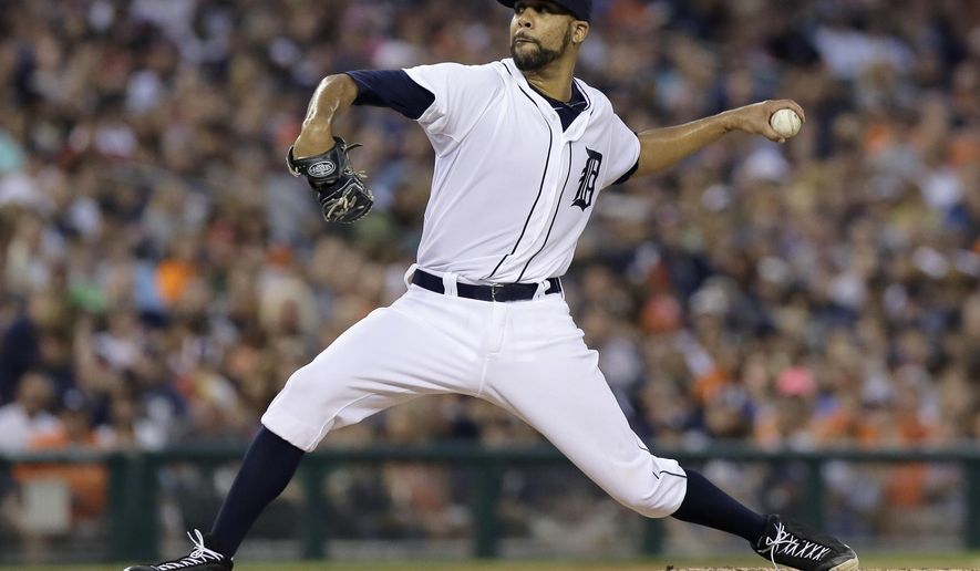 Detroit Tigers pitcher David Price delivers against the Seattle Mariners during the fifth inning of a baseball game Saturday, Aug. 16, 2014, in Detroit. (AP Photo/Duane Burleson)