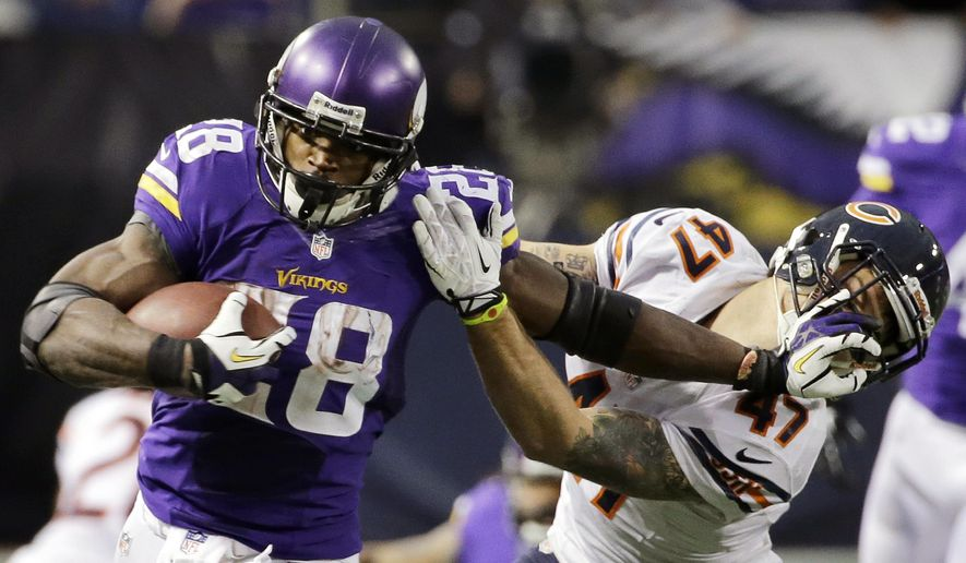 FILE - In this Dec. 1, 2013, file photo, Minnesota Vikings running back Adrian Peterson, left, tries to break a tackle from Chicago Bears free safety Chris Conte during the fourth quarter of an NFL football game in Minneapolis. Long before quarterbacks took center stage, the NFL was a running backs league. From Red Grange to Jim Brown to O.J. Simpson to Walter Payton to Emmitt Smith, the workhorse back has been a symbol of toughness and perseverance. (AP Photo/Ann Heisenfelt, File)