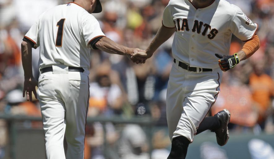 San Francisco Giants' Hunter Pence, right, is congratulated by third base coach Tim Flannery (1) after Pence hit a home run off Philadelphia Phillies' Kyle Kendrick in the first inning of a baseball game Saturday, Aug. 16, 2014, in San Francisco. (AP Photo/Ben Margot)