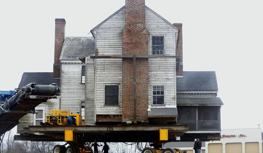 File- This Feb. 4, 2014, file photo shows the historic The Crabtree Jones House, a 3,448-square-foot Federal-style plantation home built in 1795, being moved to a new foundation on nearby in Raleigh, N.C. The tax credit that helped people rescue historic businesses and homes in 90 of North Carolina's 100 counties will expire since legislators didn't renew it. (AP Photo/The News & Observer, Travis Long, File)