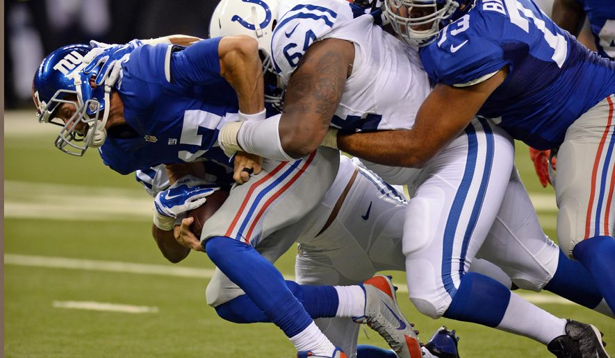 New York Giants quarterback Curtis Painter (17) is sacked by Indianapolis Colts' Zach Kerr (64) during the second half of an NFL preseason football game Saturday, Aug. 16, 2014, in Indianapolis. (AP Photo/Chris Howell)