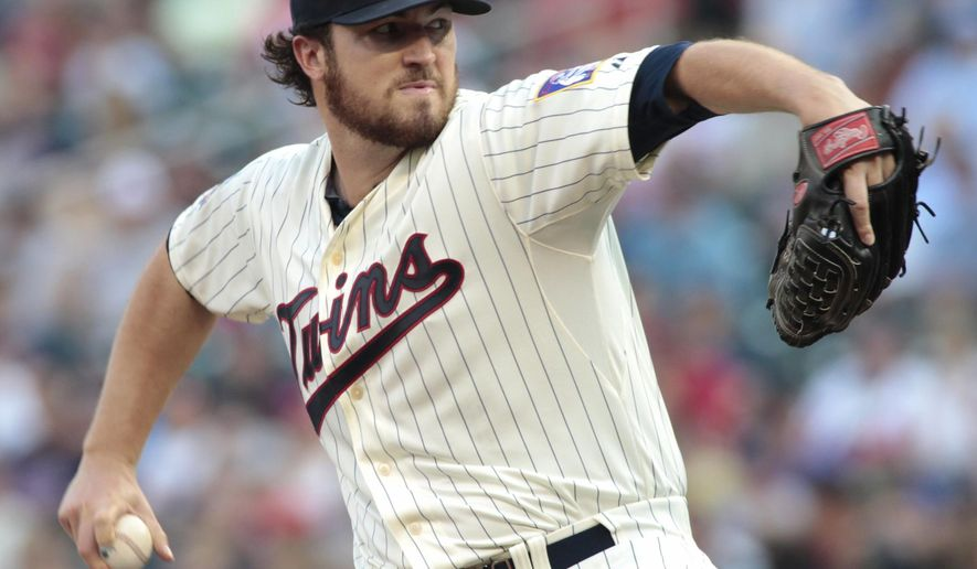 Minnesota Twins starting pitcher Phil Hughes delivers during the first inning of a baseball game against the Kansas City Royals, Saturday, Aug. 16, 2014, in Minneapolis. (AP Photo/Paul Battaglia)