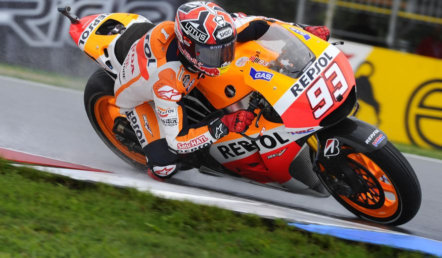 Marc Marquez of Spain rides during a practice for the motorcycle Grand Prix MotoGP race at the Brno circuit, Czech Republic, Friday Aug. 15, 2014. (AP Photo/CTK, Vaclav Salek) SLOVAKIA OUT