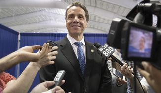 ** FILE ** In this Aug. 9, 2014, file photo, New York Gov. Andrew Cuomo speaks to the media following a news conference and bill signing that authorizes New York City to lower their speed limit in New York. (AP Photo/John Minchillo, File)