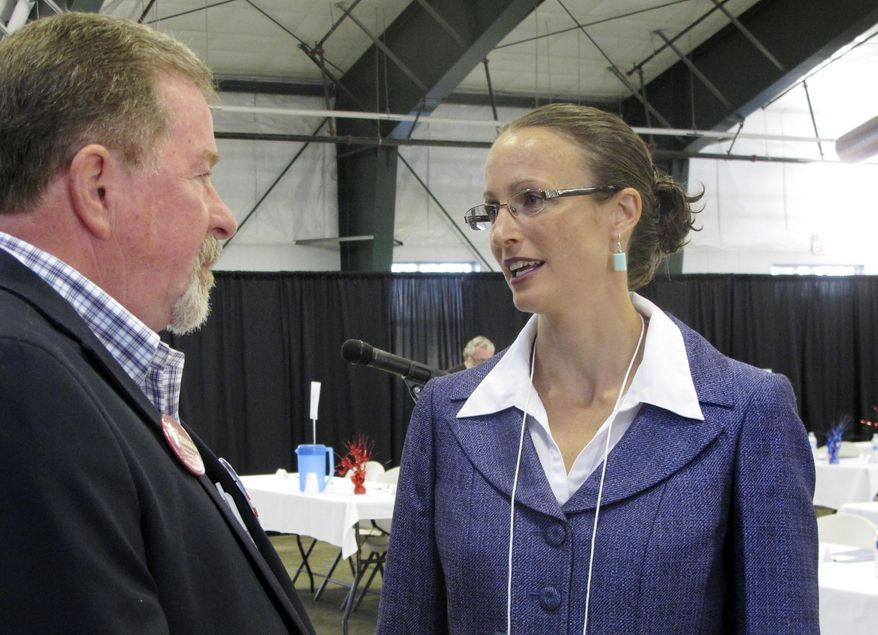 Amanda Curtis speaks with Ravalli County delegate Lee Tickell before the opening of the Montana Democratic Party's special nominating convention in Helena, Montana, Saturday, Aug. 16, 2014.  Curtis, a legislator from Butte, is one of the candidates seeking the party's nomination to replace Sen. John Walsh in the Senate race against Republican U.S. Rep. Steve Daines. (AP Photo/Matt Volz)