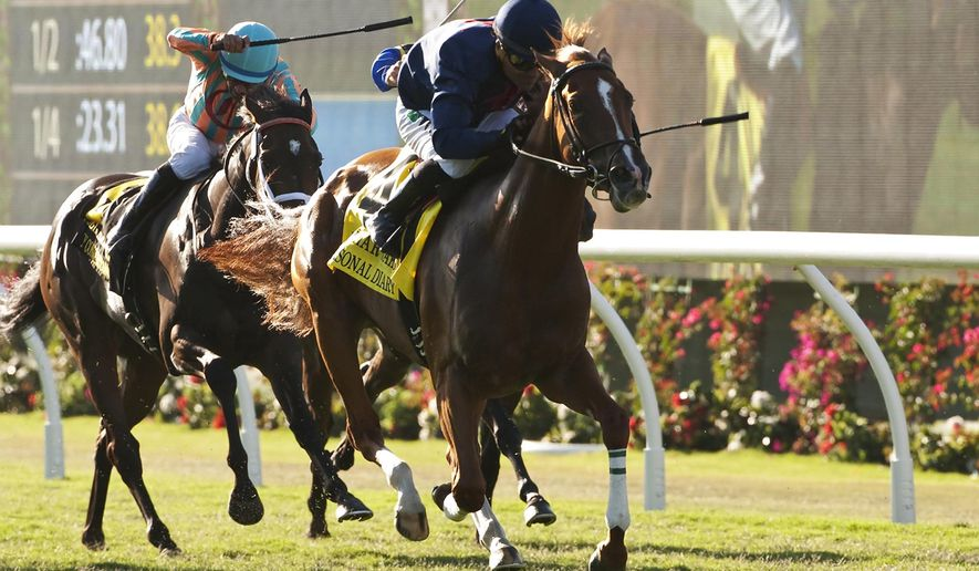 Personal Diary and jockey Corey Nakatani, right, outleg My Conquestadory with jockey Victor Espinoza, left, to win the Grade I, $300,000 Del Mar Oaks, Saturday, Aug. 16, 2014 at Del Mar Thoroughbred Club, Del Mar. Calif. (AP Photo/Benoit Photo) NO SALES
