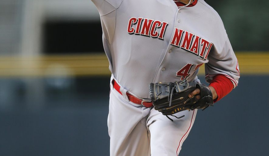Cincinnati Reds starting pitcher Johnny Cueto throws to a Colorado Rockies batter during the first inning of a baseball game Friday, Aug. 15, 2014, in Denver. (AP Photo/Jack Dempsey)