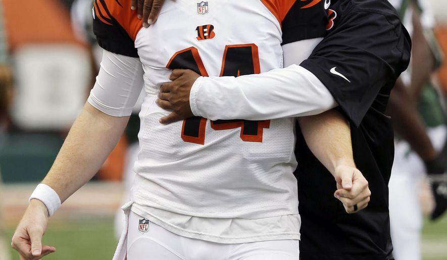 Cincinnati Bengals offensive coordinator Hue Jackson hugs quarterback Andy Dalton (14) prior to an NFL preseason football game against the New York Jets, Saturday, Aug. 16, 2014, in Cincinnati. (AP Photo/Al Behrman)