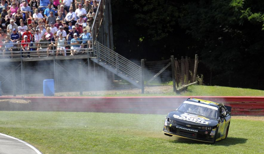 Jeffrey Earnhardt slides off course in Turn 4 during the NASCAR Nationwide Series Nationwide Children's Hospital 200 auto race at Mid-Ohio Sports Car Course Saturday, Aug. 16, 2014, in Lexington, Ohio. (AP Photo/Tom E. Puskar)