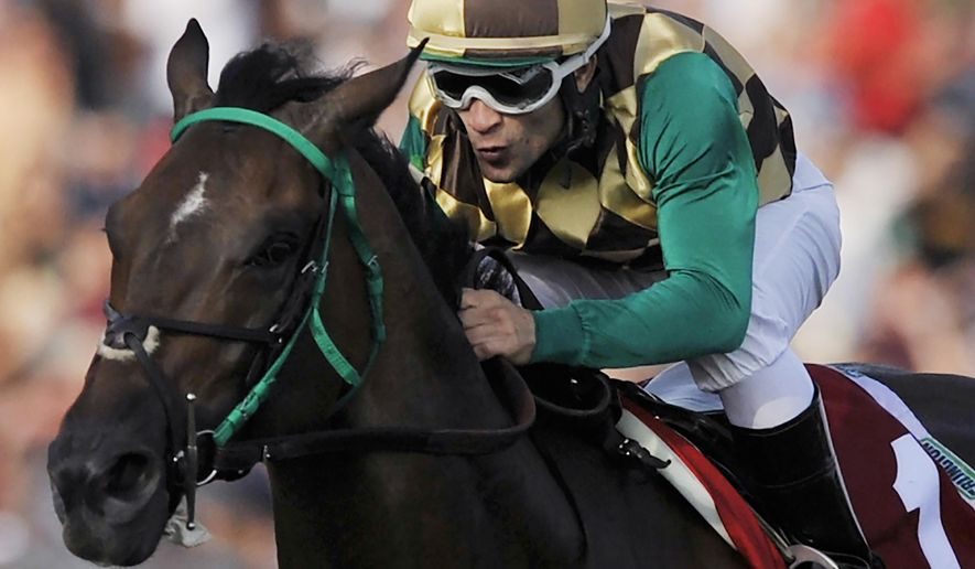 Eriluis Vaz rides Hardest Core to a win in the Arlington Million horse race at Arlington International Racecourse in Arlington Heights, Ill., Saturday, Aug. 16, 2014. (AP Photo/Paul Beaty)