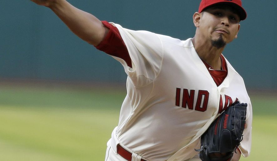 Cleveland Indians starting pitcher Carlos Carrasco delivers in the first inning of a baseball game against the Baltimore Orioles, Saturday, Aug. 16, 2014, in Cleveland. (AP Photo/Tony Dejak)