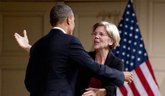 President Obama hugs Elizabeth Warren as he arrives to speak at a campaign event at Symphony Hall, June 25, 2012, in Boston. (Associated Press)