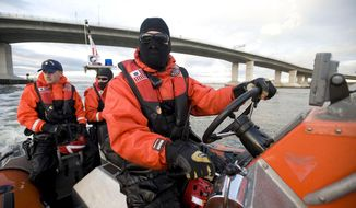 FILE -In this Nov. 3, 2012 file photo provided by the U.S. Coast Guard, a small-boat crew patrols near Sandy Hook, N.J., during the agency's first patrol of Sandy Hook waterways since Superstorm Sandy hit the region a week earlier. For the Coast Guard, the devastation to Sandy Hook altered the mission there. Piers and mooring stations were broken apart and base housing for more than 30 families had to be abandoned after a sewerage treatment plant shared with the National Park Service was knocked out of operation. (AP Photo/U.S. Coast Guard/ Petty Officer 2nd Class Erik Swanson, File)