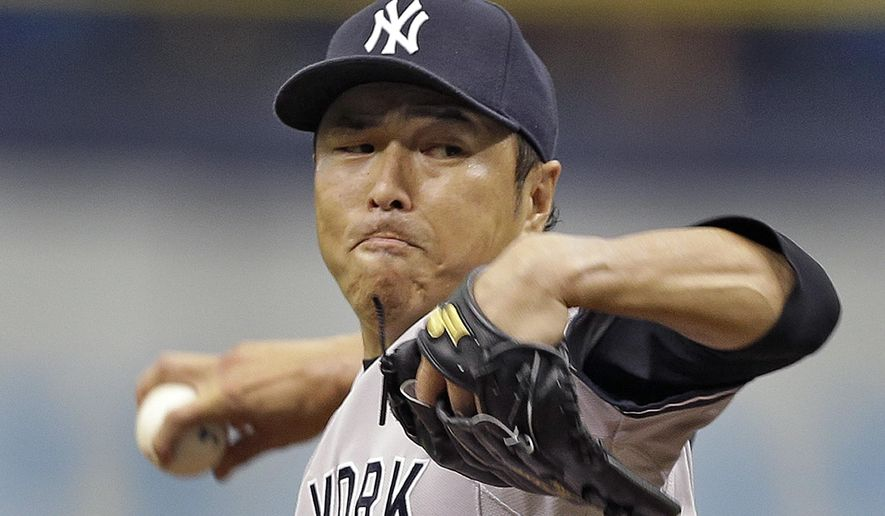 New York Yankees starting pitcher Hiroki Kuroda, of Japan, delivers to the Tampa Bay Rays during the first inning of a baseball game Sunday, Aug. 17, 2014, in St. Petersburg, Fla. (AP Photo/Chris O'Meara)