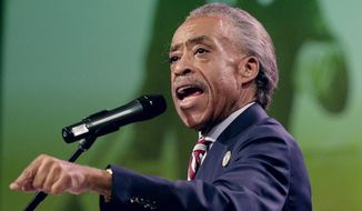 Rev. Al Sharpton speaks at a rally at Greater Grace Church, Sunday, Aug. 17, 2014, for Michael Brown who was killed by police, last Saturday in Ferguson, Mo. Brown's shooting in the middle of a street, following a suspected robbery of a box of cigars from a nearby market, has sparked a week of protests, riots and looting in the St. Louis suburb. (AP Photo/Charlie Riedel)