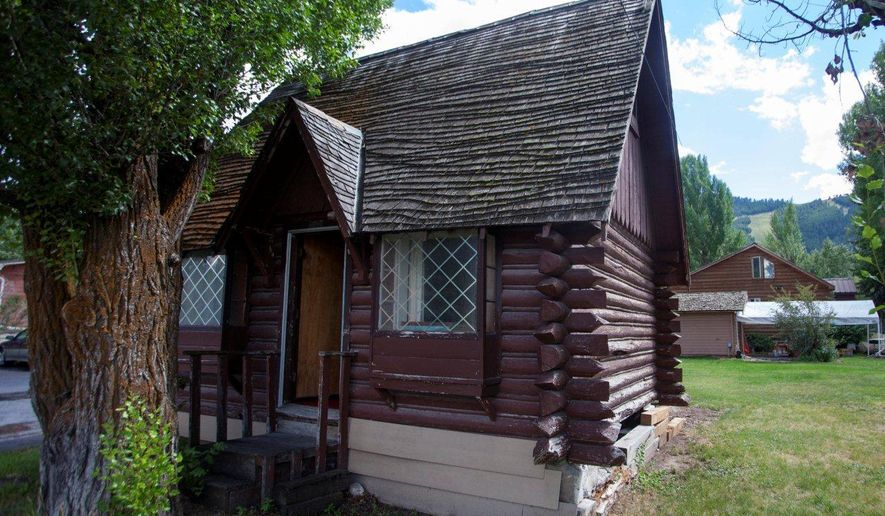 This Aug. 15, 2014 photo shows a historic cabin in Jackson, Wyo., that is slated to be torn down on Aug. 22, 2014, unless someone offers to pay to relocate it. The log cabin is a landmark among old photos of downtown Jackson. (AP Photo/Jackson Hole News & Guide, Sofia Jaramillo)