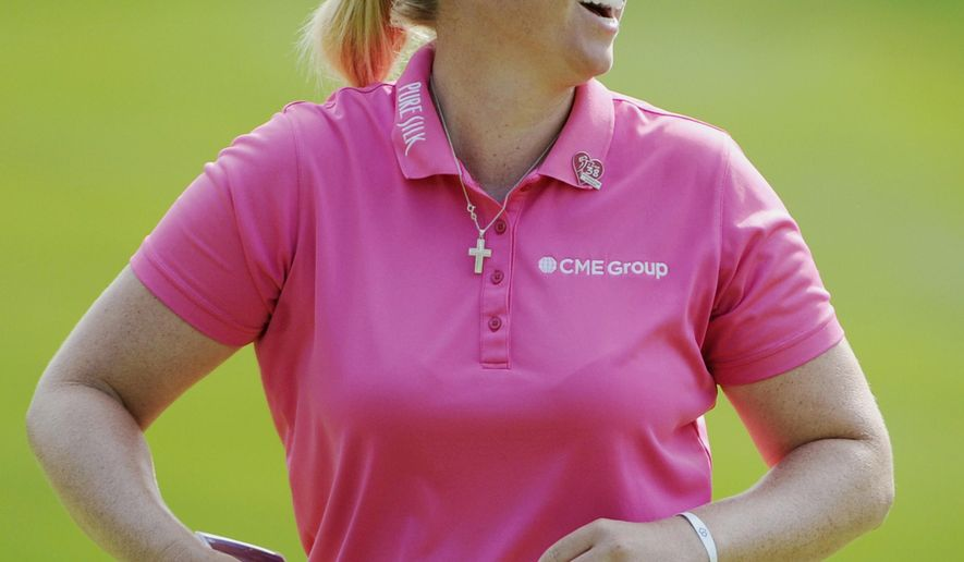 Brittany Lincicome, of Florida, reacts to her birdie shot on the 8th hole during the Wegmans LPGA golf championship in Pittsford, N.Y., Sunday, Aug. 17, 2014. (AP Photo/Gary Wiepert)