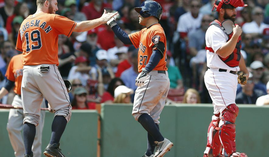 Houston Astros' Jose Altuve (27) celebrates his grand slam behind Boston Red Sox's Dan Butler, right, that also drove in Robbie Grossman during the second inning of a baseball game in Boston, Sunday, Aug. 17, 2014. (AP Photo/Michael Dwyer)