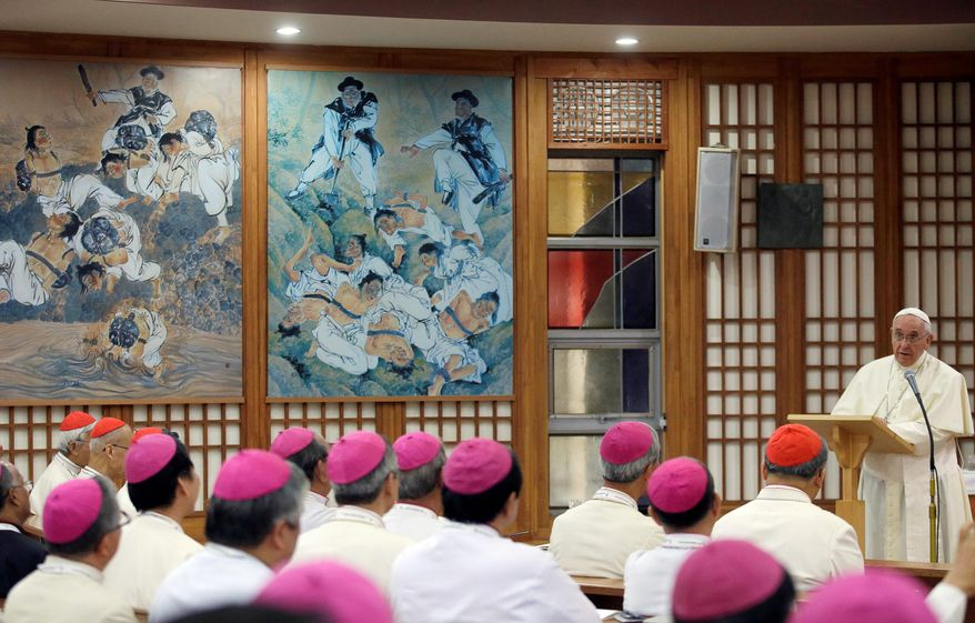 Pope Francis meets with bishops during his visit to the Shrine of Haemi in South Korea. The pontiff earlier beatified 124 Korean martyrs who died in the 18th and 19th centuries. (associated press)