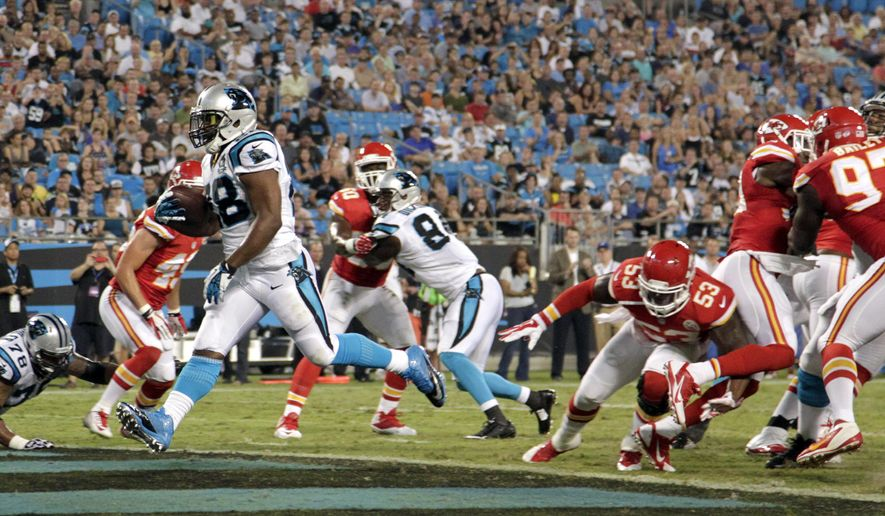 Carolina Panthers' Jonathan Stewart (28) runs into the end zone for a touchdown against the Kansas City Chiefs during the first half of a preseason NFL football game in Charlotte, N.C., Sunday, Aug. 17, 2014. (AP Photo/Bob Leverone)
