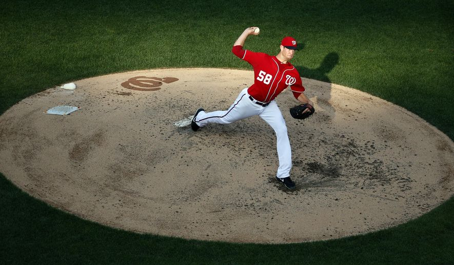 Washington Nationals starting pitcher Doug Fister throws during the fourth inning of a baseball game against the Pittsburgh Pirates at Nationals Park, Sunday, Aug. 17, 2014, in Washington. (AP Photo/Alex Brandon)