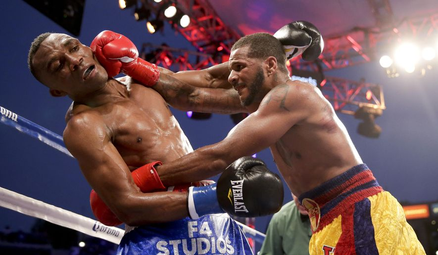 Sakio Bika, left, gets hit by Anthony Dirrell during their WBC super middleweight title boxing bout Saturday, Aug. 16, 2014, in Carson, Calif. (AP Photo/Chris Carlson)