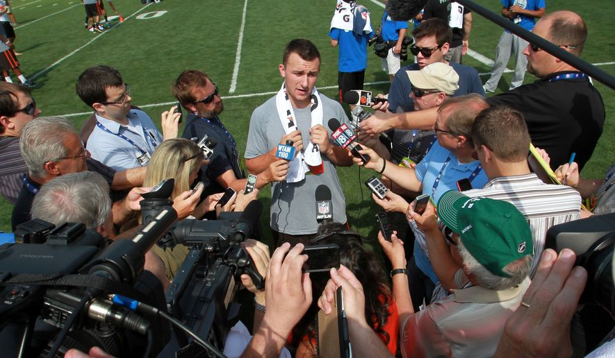 Cleveland Browns' Johnny Manziel talks to the media during an NFL football Play 60 youth event at the Cleveland Browns practice facility Friday, June 27, 2014, in Berea, Ohio. The AFC rookies took part in the NFL's annual Rookie Symposium. (AP Photo/Aaron Josefczyk)