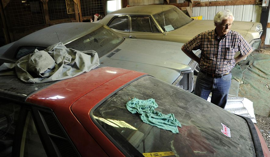 ADVANCE FOR USE SUNDAY, AUG. 17 - In this photo taken on Tuesday, Aug. 12, 2014, Roger Pickering assesses damage to vehicles he stores indoors, and outside, at a property east of Lincoln, Neb., in Lancaster County. For several months, vandals have been targeting the small collection of antique cars. (AP Photo/The Journal-Star, Eric Gregory) LOCAL TELEVISION OUT; KOLN-TV OUT; KGIN-TV OUT; KLKN-TV OUT